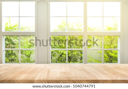 Top of wood table counter on blur window view garden background.For montage product display or design key visual layout #1040744791