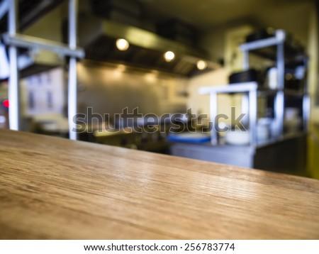 Top of Wooden counter with Blurred Kitchen Restaurant Interior Background