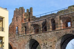 Top part of the remains of the medieval boat entrance portal over the river Berkel part of the historic defense wall with rook and arches of protective brick construction in Dutch city Zutphen