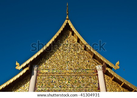 Top part of traditional northern Thai style church, Wat Jedi Laung, Chiang Mai, Thailand