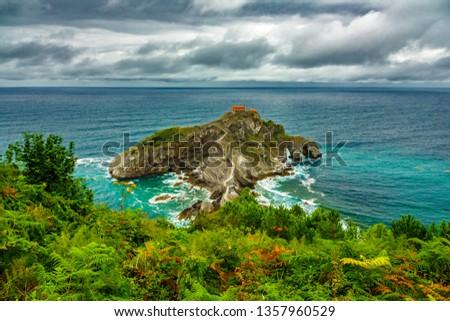 Top saturated view of San Juan de Gaztelugatxe islet under the storm #1357960529
