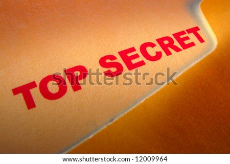Top secret confidential document inside a manila file folder