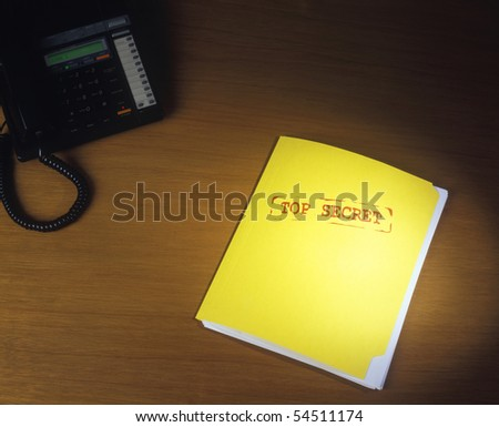 Top Secret Folder on Desk