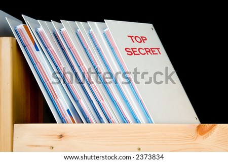 Top secret folders on the shelf, isolated on black