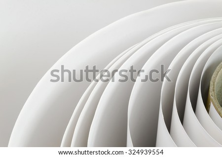 Top shot macro Paper roll swirl in a printshop, horizontal ストックフォト ©