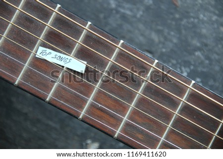top songs idea, the tag with the inscription and guitar #1169411620