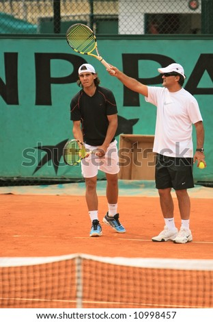 Top Spanish tennis player Rafael Nadal and his coach Tony Nadal at Roland Garros, Paris, France during a practicing session.