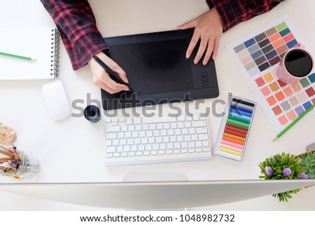 Top view a artist workplace with graphic designer working on workspace desk.
