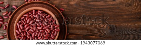 Top view a bowl of raw red beans on a wooden background banner with copy space. Photo stock ©