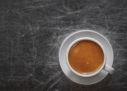 Top view a cup of espresso coffee on silvery background with copy space
