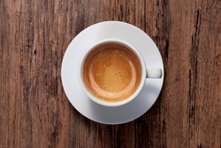 top view a cup of espresso coffee on wooden table background