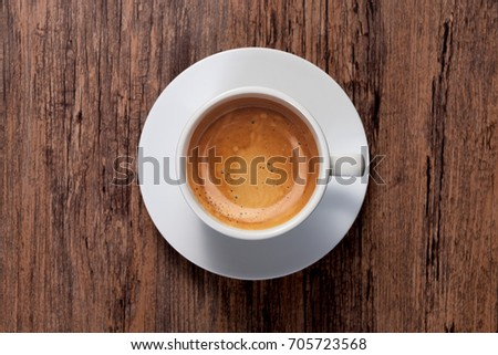 top view a cup of espresso coffee on wooden table background #705723568