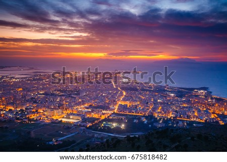 Top view above the city illuminated with lights. Dramatic and picturesque scene. Location place Trapani town, Erice, Sicilia, Italy, Europe. Mediterranean and Tyrrhenian sea. Beauty world. #675818482