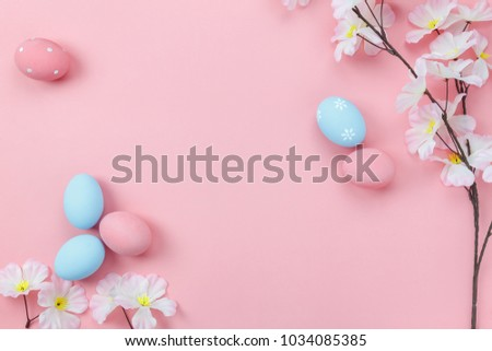 Photo of Top view aerial image of decoration & symbol Happy Easter holiday background concept.Flat lay accessory bunny eggs & floral on modern beautiful pink paper at home office desk.Free space for design.