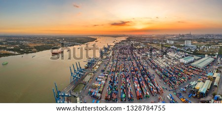 Photo of Top view aerial of Cat Lai container harbor, center Ho Chi Minh City, Vietnam with development buildings, transportation, energy power infrastructure.