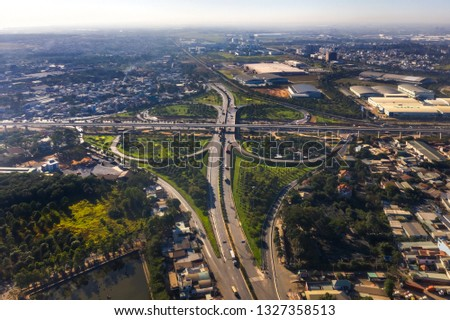 """Top view aerial of """" Tram 2 """" overpass, intersection of 1A national road with Hanoi highway. Ho Chi Minh City, Vietnam. View from Thu Duc district to district 9"""