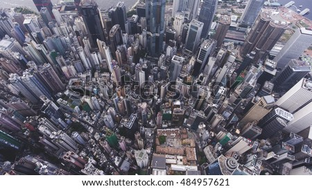 Top view aerial photo from flying drone of a big China town with skyscrapers roofs and business centers. Big city with advanced buildings infrastructure, tall office skyscrapers, streets and roads