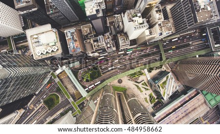 Top view aerial photo from flying drone of a developed Hong Kong city with modern skyscrapers with contemporary design. China town with business and financial centers and road with cars #484958662