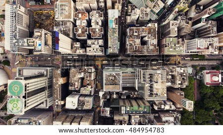 Top view aerial photo from flying drone of a HongKong Global City with development buildings, transportation, energy power infrastructure. Financial and business centers in developed China town