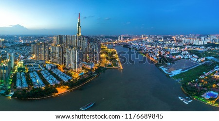 Top view aerial photo from flying drone of center city, a developed metropolitan with office skyscrapers and business center.Ho Chi Minh city with tall buildings