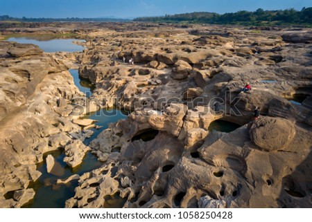 Top view Aerial photo from flying drone over Grand canyon of Thailand / stone mountain at Sam Phan Bok,Ubonratchathani province,Thailand. #1058250428