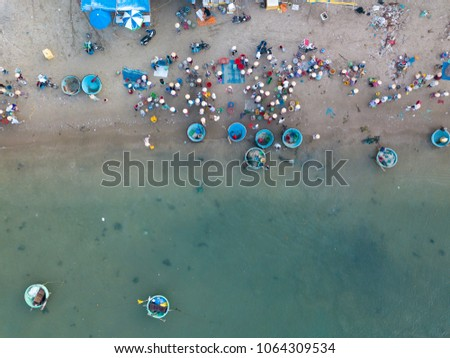 Top view. Aerial view fishing harbour market from drone. Royalty high quality free stock image of market at Mui Ne fishing harbour or fishing village. Fishing harbor is a popular tourist destination