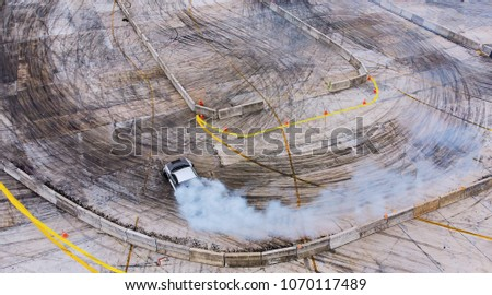 Top view Aerial view photo driver drifting car on asphalt track,Car drift ,Race,Motorsport #1070117489