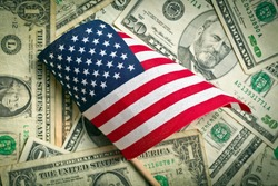top view american flag on us dollars background