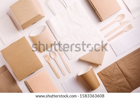 Top view and flat lay concept of Food kraft paper packaging for food delivery. Paper food boxes from eco friendly materials on white background Photo stock ©