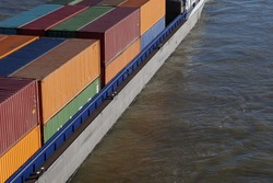 Top view and selective focus at containers on container ship on river.