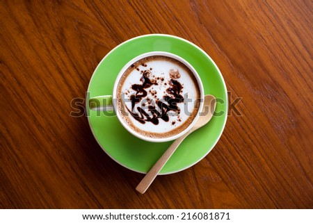 top view art hot coffee in green cup