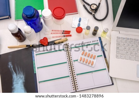 Top view at medical results and notepads on table