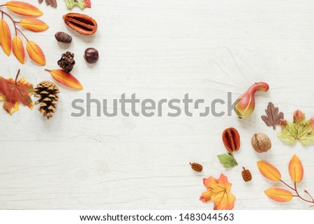 Top view autumn arrangement with wooden background #1483044563