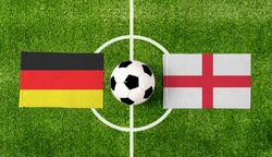 Top view ball with Germany vs. England flags match on green soccer field.