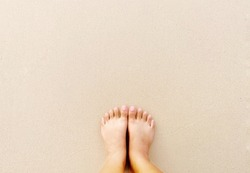 Top view bare feet selfie on sand beach background with copy space, summer vacation concept