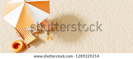 Top view Beach umbrella with chairs and beach accessories on the sand background. summer vacation concept. 3d rendering