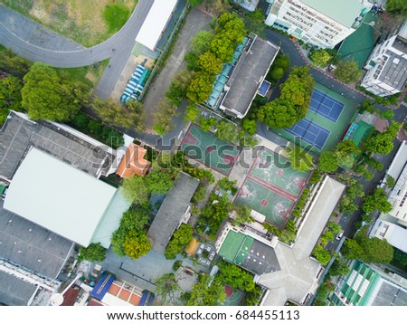 Top View, Bird eye view of school college with Basketball court and football soccer field.