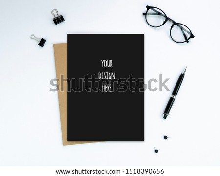 Top view Blank blank diary notepad cover with pen, hipster glasses and clips isolated on white