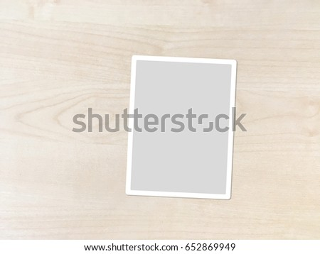 Top View Blank Paper Photo Frame on Wood Texture Background, Clipping Path Included