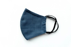 Top view blue fabric mask on white background