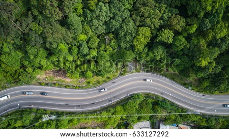 Top view car and road on the hill in Phuket, Thailand. Aerial view from flying drone.