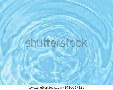 top view Close Up blue water rings, clear water, Close-up water droplets affect the surface splash in the pool, forming rings on the surface. reflections in blue water.
