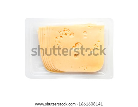 top view close-up of square cheese radamer slices in a package isolated on a white background. Slices of swiss cheese.Maasdam - Dutch hard cheese with large holes.