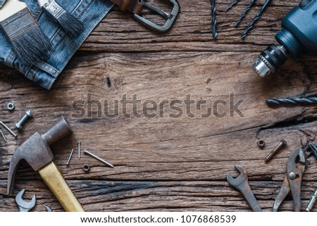 Top view close up of variety handy tools and jeans on wood background with copy space for your text for Worker\'s day, Labor\'s day, labour\'s day background.