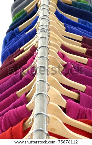 Top view colored Tee Shirts hanging