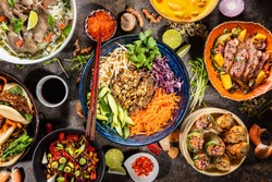 Top view composition of various Asian food in bowls, free space for text