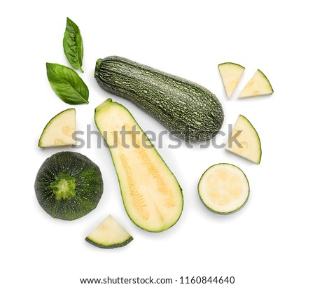 Top view composition with sliced zucchini on white background