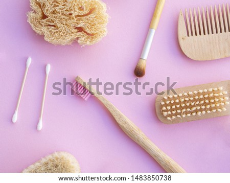 Top view cosmetic items on pink background