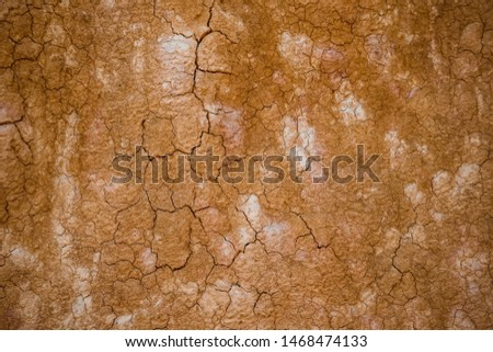 top view cracked  red soil ground Earth for texture background,desert cracks,Dry Orange surface Arid,drought land,Picture of natural disaster. drought land Caused by global warming and deforestation. #1468474133
