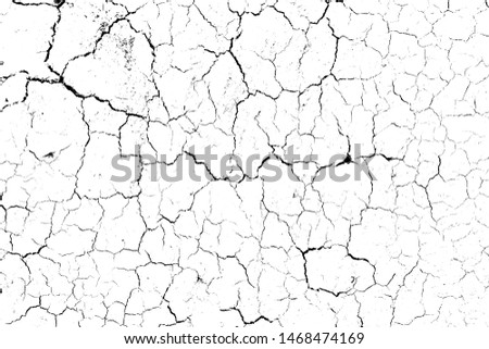 top view cracked soil ground Earth texture on white background, desert cracks,Dry surface Arid in drought land, floor has many grooves and scratches. The distressed has been shown to last a long time. #1468474169